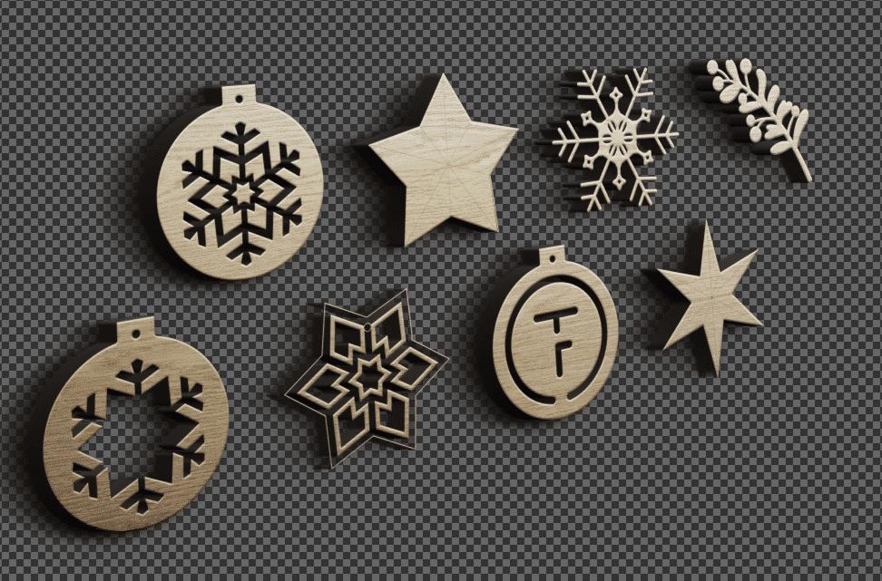 gelaserte holzanhaenger mit weihnachtlichen Motiven vor einer grauen wand